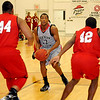NOC Jets' Marquavius Williams (center) pauses in the lane for a shot against Bacone JV's Kevone Hargrove (44) and Tyrone Allen (42) during the Jets' 126-50 win at the Mabee Center Wednesday, Nov. 13, 2013. (Staff Photo by BONNIE VCULEK)