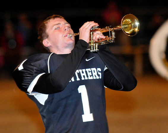 Pond Creek-Hunter's Karington Johnson plays the trumpet at halftime Friday during the first round of the Class B state playoffs. (Staff Photo by BILLY HEFTON)