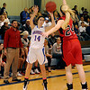 Waukomis Lady Chiefs' MacKenna Mack shoots over the outstretched arm of OBA's Ashley Atwood during basketball action at Waukomis High School Friday, Nov. 22, 2013. (Staff Photo by BONNIE VCULEK)