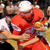 Chisholm's Bryce Stewart fights for extra yardage against Tonkawa Friday, Nov. 8, 2013. (Staff Photo by BONNIE VCULEK)