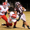 Ringwood's Richard Navarro tackles Garber's Trenton Harmon during the Wolverines' 28-18 win over the Red Devils at Warren Dell Stadium Friday, Nov. 1, 2013. (Staff Photo by BONNIE VCULEK)