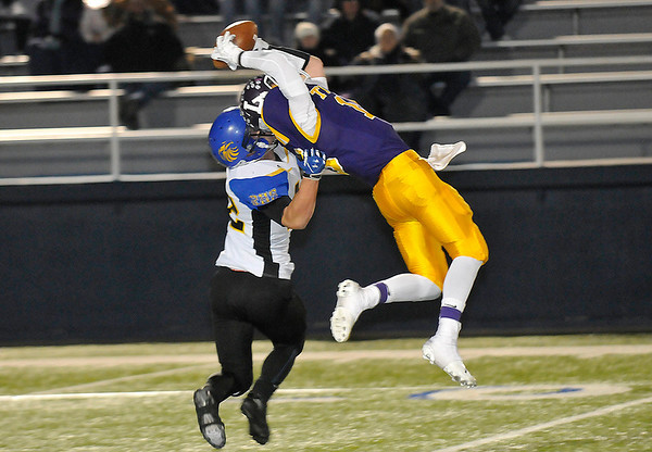 Laverne's Colten Person makes a leaping catch in front of Rejoice Christian's Jace Sanchez Friday at D. Bruce Selby Stadium during the Class B state semi-finals. (Staff Photo by BILLY HEFTON)