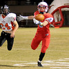 Chisholm's Danner Kiernan reaches for a Taggart Brown pass as Tonkawa's Kevin Howard defends during the Longhorns' win over the Buccaneers at Chisholm Friday, Nov. 8, 2013. (Staff Photo by BONNIE VCULEK)