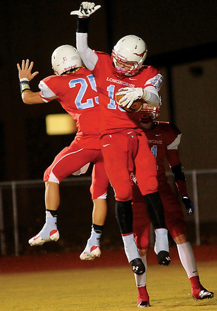 Chisholm's Britton Yunker and Karsten Brady celebrate a Longhorn touchdown during fourth quarter action against Tonkawa at Chisholm High School Friday, Nov. 8, 2013. Chisholm won 33-8. (Staff Photo by BONNIE VCULEK)