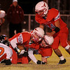 Chisholm's Karsten Brady (10) recovers a Tonkawa fumble during the Longhorn's win Friday, Nov. 8, 2013. (Staff Photo by BONNIE VCULEK)