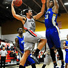 NOC Enid's Ben Berry goes up against Eastern's Olando Bobo Thursday at the Mabee Center. (Staff Photo by BILLY HEFTON)