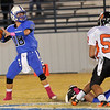 Hennessey quarterback, Tony Mendoza, lets loose a long pass against Tonkawa Friday at Hennessey High School. (Staff Photo by BILLY HEFTON)