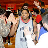NOC Jets' Cornell Neal and the rest of the players receive high fives from the fans after the Jets' 126-50 win over the Bacone JV Warriors Wednesday, Nov. 13, 2013, at the Mabee Center. (Staff Photo by BONNIE VCULEK)