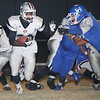 Oklahoma Bible Academy's Chris Walker (20) avoids Hooker's Alex Juarez (72) Friday night in Hooker. The Trojans picked up a 6-0 win in the Panhandle. (Photo by Shawn Yorks/The Guymon Daily Herald)
