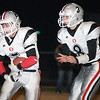 OBA's Kristian Stitt heads upfield after taking the handoff from quarterback Preston Atwood, Friday night in Hooker. The Trojans downed the Hooker Bulldogs 6-0. (Photo by Shawn Yorks/The Guymon Daily Herald)