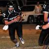 Pond Creek-Hunter's Derek Halcomb runs the ball against Waukomis Thursday November 5, 2015 in Pond Creek. (Billy Hefton / Enid News & Eagle)