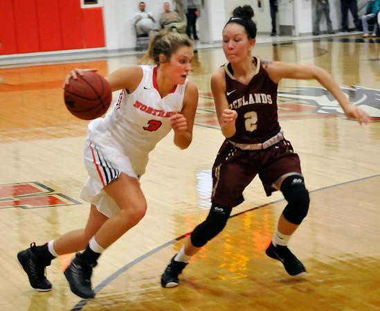 NOC Enid's Rylie Torrey drives toward the basket against Redland's Piper Kalthoff Thursday December 3, 2015 at the NOC Mabee Center. (Billy Hefton / Enid News & Eagle)