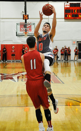 NOC Enid's Jesus Izquierdo drives to the basket against Bacone's Blake Baughman Tuesday November 10, 2015 at the NOC Mabee Center. (Billy Hefton / Enid News & Eagle)
