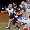 Pond Creek-Hunter's Devan McKee runs the ball against Waukomis Thursday November 5, 2015 in Pond Creek. (Billy Hefton / Enid News & Eagle)
