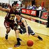NOC Enid's Jesus Izquierdo drives toward the basket against Hesston's Aubrey Johnson Tuesday November 3, 2015 at the NOC Enid Mabee Center. (Billy Hefton / Enid News & Eagle)