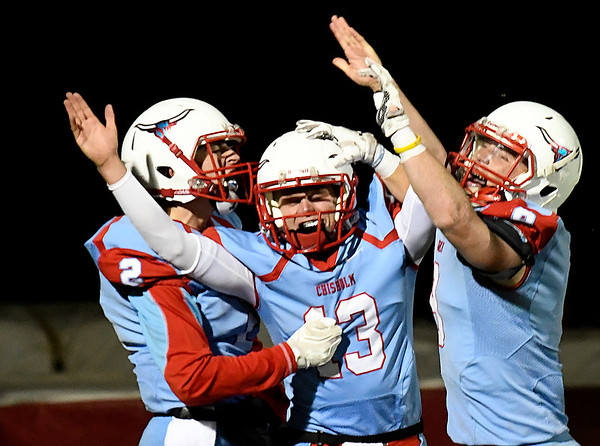 Chisholm's Braden Meeks (13) celebrates a 27 yard touchdown run against Washington with Cade Balenti (2) and Connor Pasby Friday November 18, 2016. (Billy Hefton / Enid News & Eagle)