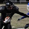 Pond Creek-Hunter's Blake Rayner gets by Corn Bible's Dakota Clayton for a 65 yard touchdown reception Friday November 18, 2016. (Billy Hefton / Enid News & Eagle)