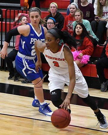 NOC Enid's Moe Tramble drives by Pratt's Channa Parvin Monday November 6, 2016 at the NOC Mabee Center. (Billy Hefton / Enid News & Eagle)