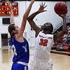 NOC Enid's Dossou Ndiaye shoots over Pratt's Megan Poole Monday November 6, 2016 at the NOC Mabee Center. (Billy Hefton / Enid News & Eagle)