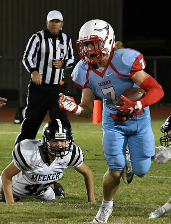 Chisholm's Mason McKee runs the ball against Meeker during the opening round of the Class 2A playoffs Friday November 11, 2016 at Chisholm High School. (Billy Hefton / Enid News & Eagle)