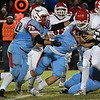 Chisholm's Beaux Biggers, Devin Fulfham and Payton Robinett stops Washington's Kylen Lanham Friday November 18, 2016. (Billy Hefton / Enid News & Eagle)