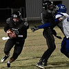 Pond Creek-Hunter's Derek Halcomb runs behind the block of Blake Rayner against Corn Bible Friday November 18, 2016. (Billy Hefton / Enid News & Eagle)