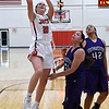 NOC Enid's Andi Pierce shoots over Southwestern JV's Alysha Michaelson and Sidney Dennis during the opening game of the season Wednesday November 1, 2017 at the NOC Mabee Center. (Billy Hefton / Enid News & Eagle)