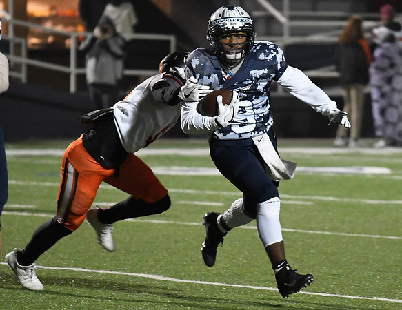 Enid's Telin Phillips carries the ball against Putnam City Friday November 3, 2017 at D. Bruce Selby Stadium. (Billy Hefton / Enid News & Eagle)