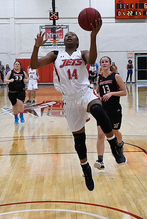 NOC Enid's Euresia Brown scores a fast break basket against Oklahoma Elite Tuesday November 14, 2017 at the NOC Mabee Center. (Billy Hefton / Enid News & Eagle)