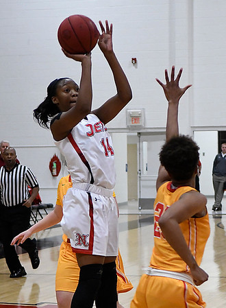 NOC Enid's Euresia Brown shoots over New Mexico JC's Ni'Asia McIntosh Monday November 20, 2017 at the NOC Mabee Center. (Billy Hefton / Enid News & Eagle)