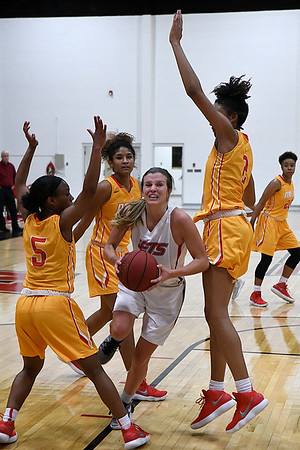 NOC Enid's McKenna Pulley drives to the basket against New Mexico JC's Alexes Bryant, Ashley Reid and Ni'Asia McIntosh Monday November 20, 2017 at the NOC Mabee Center. (Billy Hefton / Enid News & Eagle)