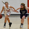 NOC Enid's Macie Jo Pierce dribbles upcourt against Southwestern JV's Kori Sanford during the opening game of the season Wednesday November 1, 2017 at the NOC Mabee Center. (Billy Hefton / Enid News & Eagle)