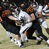 Pioneer's Z.J. Washington is stopped by Davenport's Wyatt Cross and Jaxon Walker Friday November 24, 2017 at Davenport High School during the class B state playoffs. (Billy Hefton / Enid News & Eagle)