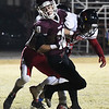 Pioneer's Garrett Mason spins away from a Turpin defender to score a touchdown during the opening round of the class B playoffs Friday November 10, 2017 at Pioneer High School. (Billy Hefton / Enid News & Eagle)