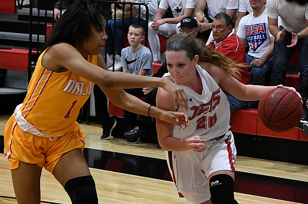 NOC Enid's Andi Pierce drives to the basket against New Mexico JC's Jurnee President Monday November 20, 2017 at the NOC Mabee Center. (Billy Hefton / Enid News & Eagle)