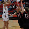 NOC Enid's McKenna Pulley puts up a shot over Oklahoma Elite's Kaitlyn Pulley and Kyndal Pulley Tuesday November 14, 2017 at the NOC Mabee Center. (Billy Hefton / Enid News & Eagle)