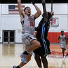 NOC Enid's Houston Johnson goes up against Link Year Prep's Shakeem Alcindor Monday November 20, 2017 at the NOC Mabee Center. (Billy Hefton / Enid News & Eagle)