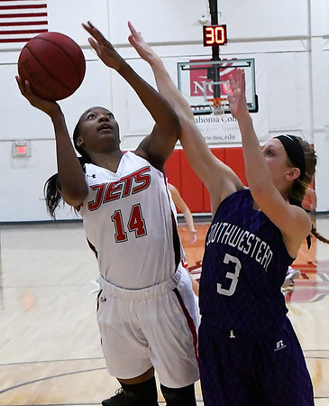 NOC Enid's Euresia Brown puts up a shot against Southwestern JV's Dominique Eule during the opening game of the season Wednesday November 1, 2017 at the NOC Mabee Center. (Billy Hefton / Enid News & Eagle)