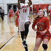 NOC Enid's Euresia Brown goes up for a fastbreak basket against Oklahoma Wesleyan JV's Avery Roberts Thursday November 9, 2017 at the NOC Mabee Center. (Billy Hefton / Enid News & Eagle)