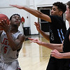 NOC Enid's Dyaire Holt drives to the basket against Link Year Prep's Cam Carson and Landon Badgley Monday November 20, 2017 at the NOC Mabee Center. (Billy Hefton / Enid News & Eagle)