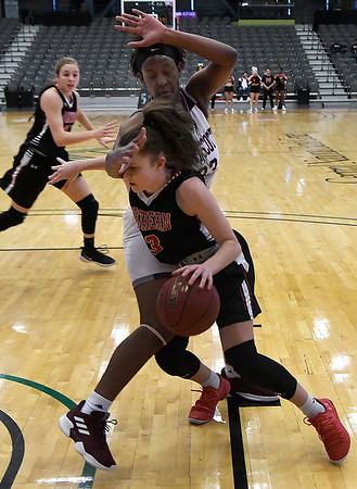 NOC Enid's Lexi Large drives to the basket against Ft. Scott's Tajshia Moore during the Chick-fil-A/Northern Oklahoma College Classic Friday November 16, 2018 at the Central National Bank Center. (Billy Hefton / Enid News & Eagle)