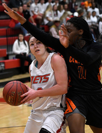 NOC Enid's Jacie Engler drives towards the basket against Connors State's Vicky Duru Tuesday November 27, 2018 at the NOC Mabee Center. (Billy Hefton / Enid News & Eagle)