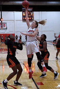 NOC Enid's Kaylee Hurst shoots over Connors State defenders Tuesday November 27, 2018 at the NOC Mabee Center. (Billy Hefton / Enid News & Eagle)