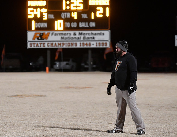 Fairview head coach, Robert Bernard watches the final minutes of the Yellowjacket's win over Commerce during the Class A quarterfinals Friday November 23, 2018 at Fairview. (Billy Hefton / Enid News & Eagle)