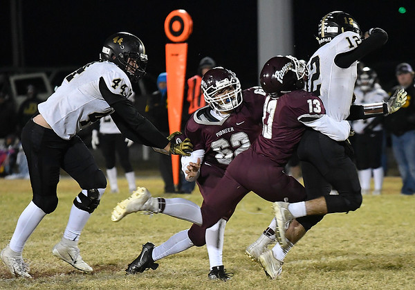 Pioneer's Marzell Washington and Gilberto Camarena pressure Seiling's Bryson Gore during the first round of the Class B playoffs Friday November 9, 2018. (Billy Hefton / Enid News & Eagle)
