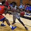 NOC Enid's Rance Kendrick tries to drive pass Hutchinson CC's Rheaquone Taylor Tuesday November 6, 2018 at the NOC Mabee Center. (Billy Hefton / Enid News & Eagle)