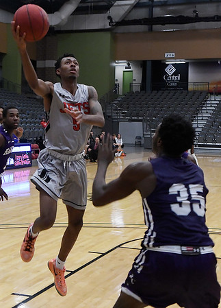 NOC Enid's C.J. Jones puts up a shot against Ranger College's Jonathan Jackson during the Chick-fil-A/Northern Oklahoma College Classic Saturday November 17, 2018 at the Central National Bank Center. (Billy Hefton / Enid News & Eagle)