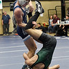 Enid's Austin Hisey turns Santa Fe's Nathan Campbell on his head during their 126-pound match Thursday November 29, 2018 at Waller Middle School. (Billy Hefton / Enid news & Eagle)