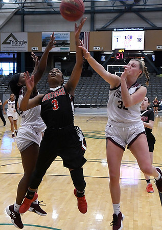 NOC Enid's Monique Tramble puts up a shot in the lane between Ft. Scott's Mariah McKinney and Ally McKenzie during the Chick-fil-A/Northern Oklahoma College Classic Friday November 16, 2018 at the Central National Bank Center. (Billy Hefton / Enid News & Eagle)