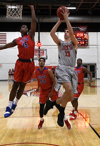 NOC Enid's José Alcala-Sanchez drives the lane against Hutchinson CC's Rheaquone Taylor Tuesday November 6, 2018 at the NOC Mabee Center. (Billy Hefton / Enid News & Eagle)